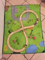 Wooden train set with road mat