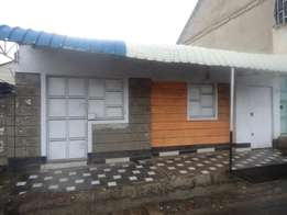 Komarock 3bedroom bungalow for sale. With 2 shops fronting the road.