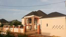 A Charming 4bedroom duplex with rooms in suite.