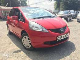 Honda Fit/2010/KCP REG/Price 690,000/= 1300cc/2WD/Auto/ Petrol/Red