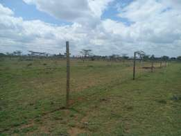 20 acres prime Land along Namanga Rd and near KAG university.