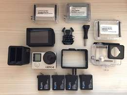 GoPro Hero4 Black with LCD Back Pack as well as 4 batteries