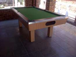Wooden pool table in excellent condition with ques and balls