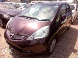 newly arrived maroon Honda Fit KCN
