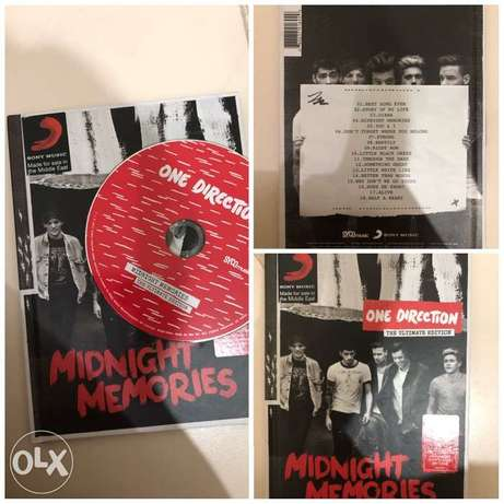 One Direction's Albums, Poster, and a magazine