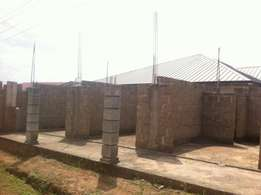 Uncompleted 3 single rooms with storey foundation at Oyarifa