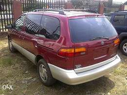 Red sparkling neat Toyota Sienna for sale