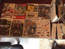 Wii console with games and controls - Make me an offer
