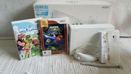 Nintendo Wii in box with all Accessories and Games