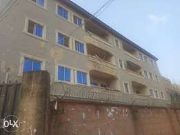 Newly built 3bedroom of 8flats at agbani Road for sale