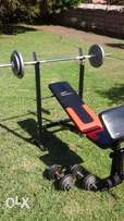 Bench, bars and 50kg weights.