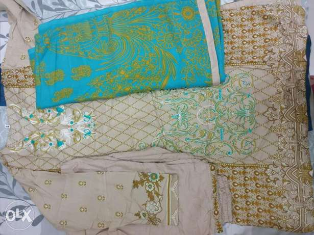 Linen stitched embroidered dresses