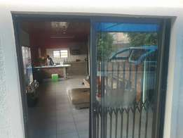 Secure 2 bedroom morden flat with alarm, carport and lovely garden