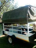 Trailor with canvice roof +- 1.8 high