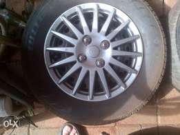 100 pcd steel rims with tyres and wheel caps