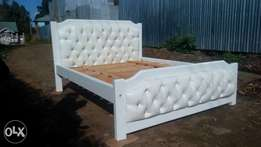 5/6 white buttoned beds.