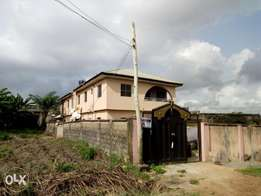 A story building with two bed room bungalow in BQ at Akesan Lagos