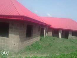 Uncompleted Twins 3 Bedroom and 2 Bedroom and plus Half Plot in Akobo