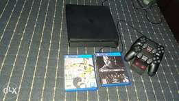 Play Station 4,1 T.B,2pads,1 wireless dock charger,Fifa 17 & Mortal k.