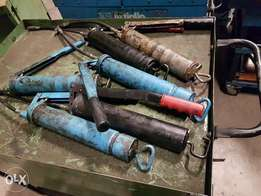 assorted workshop tools- grease gun available for grabs.