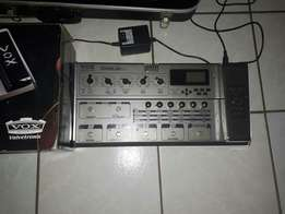 Electric guitar in case with pedal