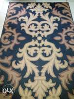 Neatly used large centre rug for sale