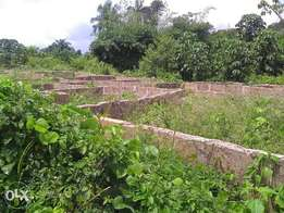land with 3 flats foundation for sale at ogba off Aiport rd