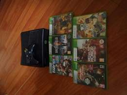 Xbox 360 slim with 6 games R1700