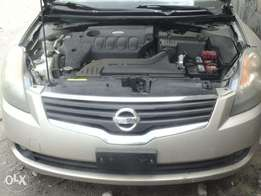 Imported, 2009 Nissan Altima, Push to start , brown. Tican clearing