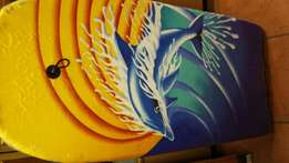 Beautiful Surf board-sealed. Big size. Brand new. plastic on it still.