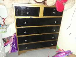 700 for 3pc t.v. unit and chest of draw