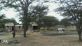 1/4 acre plot for sale with 1 bedroom house water tanks and high powe