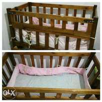 Baby cot for sale with free mattress, mattress cover and bumper pads.