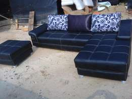 Leather And Fabric Sectional Sofa With Ottoman