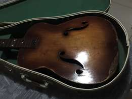 78 year old hand made guitar