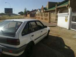 Ford Laser. R20,000 only.