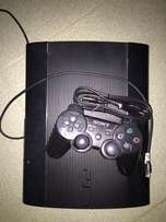 Play Station 3 Slim console plus 2 games
