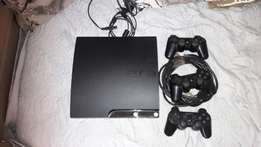 PS 3 with two controllers and 8 games
