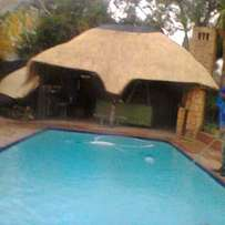 Thatch lapa and swimming pools