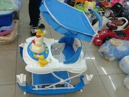 Walkers. New. With umbrella and handle. Delivery inclusive