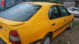Nissan primera yellow colour
