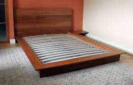 Modern bed with two side drawers