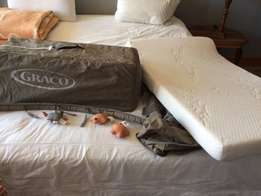 camp cot, mattress and fitted sheets