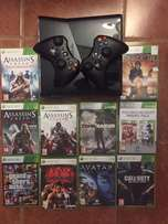 Xbox 360 with 2 remotes and 10 games.