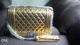 Chanel Gold sling bag