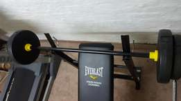 Everlast Bench and Barbell With Leg extension/curl attatchment