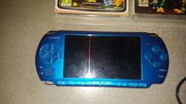 PSP and games for sale (needs new battery)