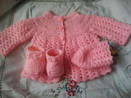 Crocheted baby sweaters for new borns