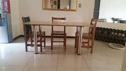 small wooden dinning table and chairs
