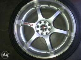 Have 17inch 4/100/108 Mags 2different colours with tyres
